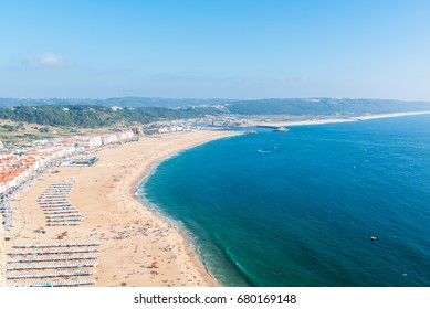 Beach in Portugal during summer, Nazare and the tiles roofs