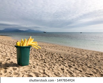 Beach with a pot of French fries