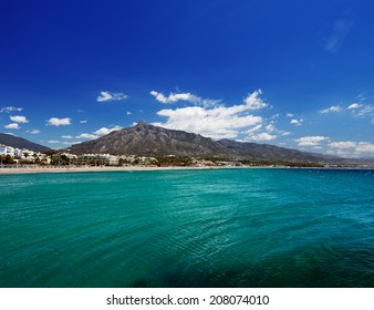 Beach in Puerto Banus, Marbella, Spain. Marbella is a popular holiday destination located on the Costa del Sol in the southern Andalusia, it lies beneath the Cordillera Penibetica mountains