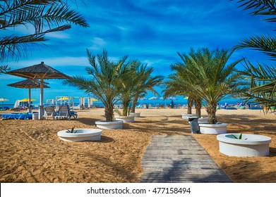The beach in Ras Al Khaimah with umbrellas and sunbeds.
