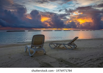 beach resort at sunset with cloudy sky