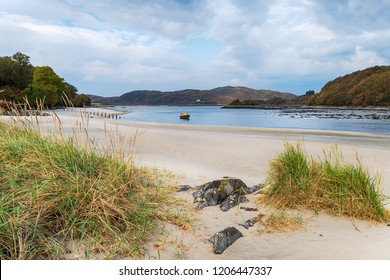 The beach and river at Morar near Mallaig in Lochaber in the Highlands of Scotland