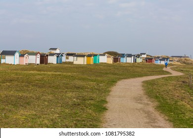 The beach road between Skanor and Falsterbo over the meadows when spring morning and with the beach huts in the background