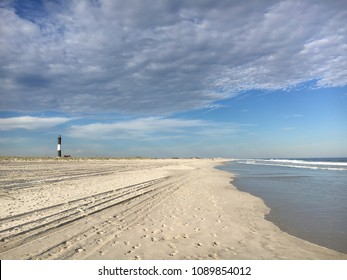 The beach at Robert Moses State Park with the Fire Island Lighthouse in the distance.