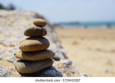 beach and rock tower on the stone