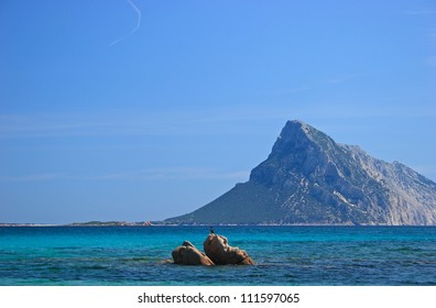 Beach and rocks in front of Isola Tavolara, Olbia, Sardinia