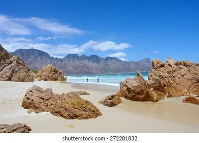Beach, rocks, mountains. Shot near Strand/Cape Town, Western Cape, South Africa.