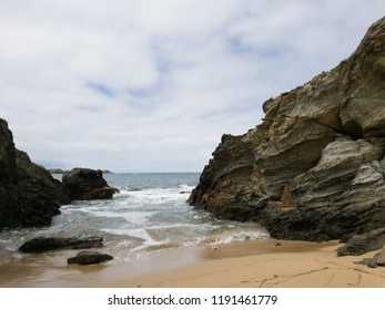 Beach with rocks on claudy day
