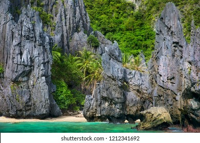 The Beach and Rocks outside the Secret Lagoon on Miniloc Island in the El Nido Archipelago, Palawan, Philippines