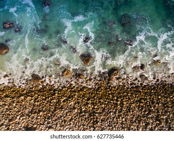 Beach rocks and shore from above
