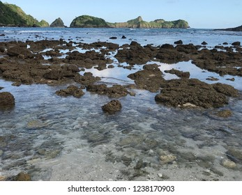 Beach rocks surrounded by hills in Wedi Ireng Beach, East Java Indonesia