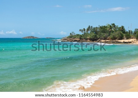 beach and rocky shoreline of atlantic ocean along north coast puerto rico outside arecibo