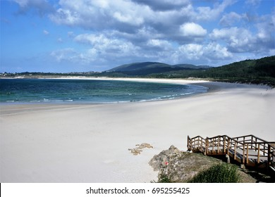 Beach of San Xurxo, Ferrol, A Coruña, Galicia, Spain, beach of several kilometers of fine sand in the form of arch, transparent turquoise and green waters,