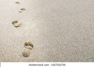 Beach sand footprints with copy space. Vacation or business concept