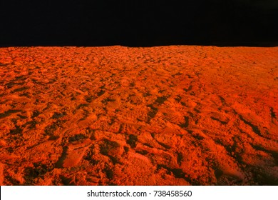 beach sand in red light looks like a surface of Mars