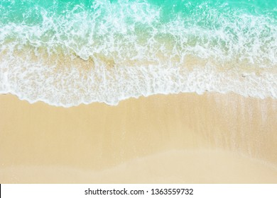 Beach Sand Sea Shore with Blue wave and white foamy summer background,Aerial beach top view overhead seaside.