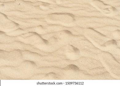 Beach sand texture, Fine beach sand in summer sun.