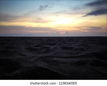 Beach Sand Waves In The Sunset Light At Batu Bolong Beach, Canggu Village, Badung, Bali, Indonesia