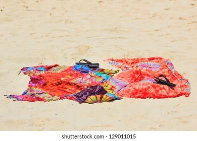 Beach sarong on golden sandy beach in Thailand