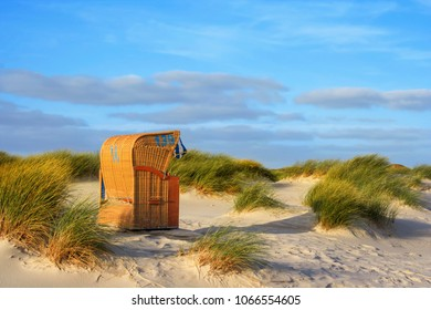 "Beach scene with beach chair on the island ""Amrum"", Northern Germany."