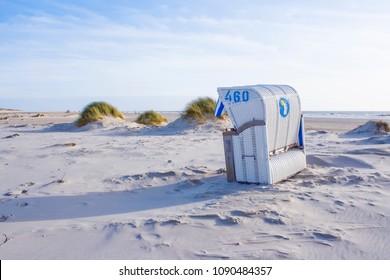 "Beach scene with beach chair on the island ""Amrum"", Northern Germany."