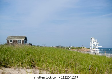 beach scene with beach house scrub brush and lifeguard chair on Ditch Plains Beach Montauk, New York, The Hamptons