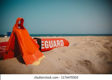 45b4f86896f Beach scene with lifeguard floatation device and flippers