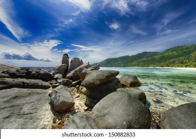 Beach Scene  over rocks Seychelles