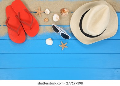 Beach scene in summer on vacation with shells, hat, copyspace