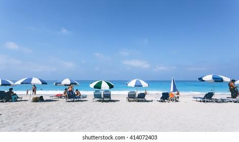 Beach scene. Sun umbrellas and beach chairs one of the most beautiful Mediterranean beaches. Greece.