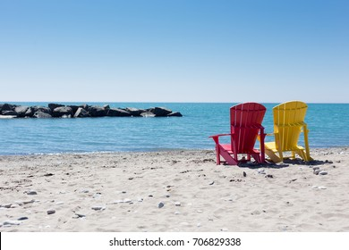 beach scene with two colorful adirondack chairs