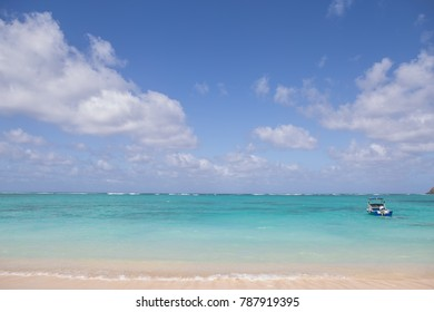 beach scenery with boat in water