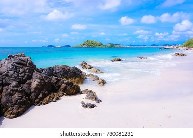 Beach scenery of relaxing beach.The summer vacation of your travel holiday.It's happy time running on the beach and beautiful clear sea water.Design of summer vacation holiday concept.
