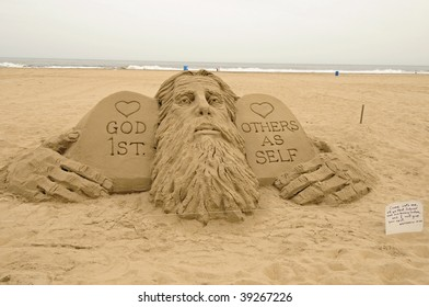 Beach sculpture depicting a man and various Bible verses found along the Eastern Shore.