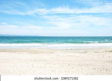 Beach and sea in bright sunlight