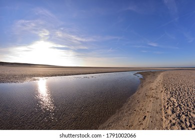 The beach and the sea coast on a sunny day in the fisheye lens. Spring.