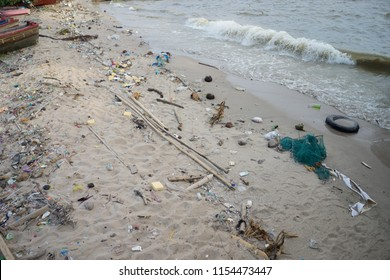 The beach and sea is full of garbages or trashes. This problem may cause by careless and selfish people, that leads to dirty beach.