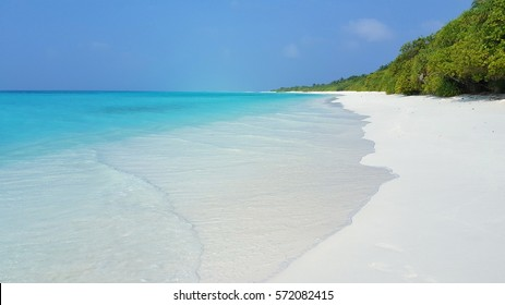 Beach and sea under the blue sky background