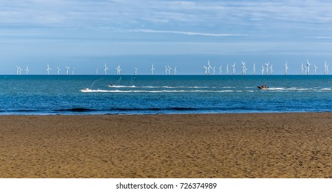 The beach, sea and wind farm at Skegness, UK in summertime