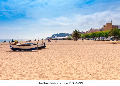 Beach at seaside in Calella in Catalonia, Spain near Barcelona. Scenic old town with sand beach and clear blue water. Famous tourist destination in Costa Brava, perfect place for holiday and vacation