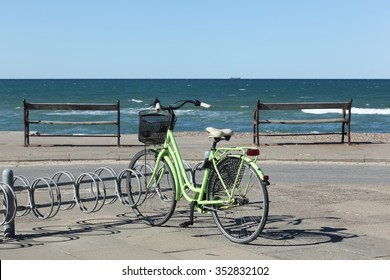 Beach and seaside at the idylic old Skagen with a green bike, Denmark