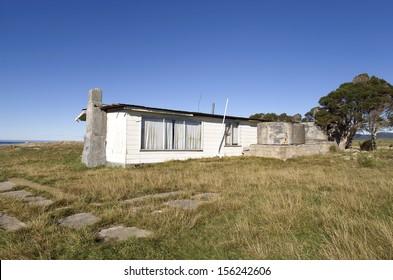 Beach shack left abandoned on the east coast of Tasmania, Australia