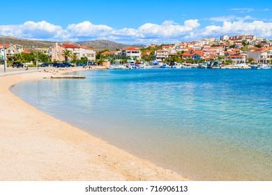 Beach with shallow crystal clear sea water in Rogoznica town, Dalmatia, Croatia