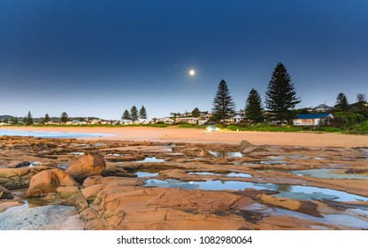 Beach and Shorescape with Moon - Capturing the sunrise and the 99.7 Waning Gibbous Moon from North Avoca Beach on the Central Coast, NSW, Australia.