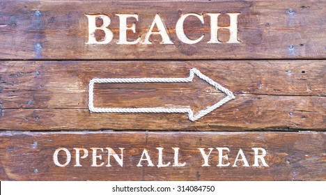 Beach sign on a wooden table