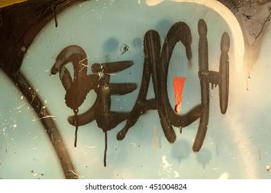 Beach sign spray painted