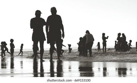 Beach silhouette people at seaside