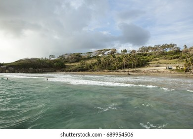 Beach at Skeetes Bay. The east coast of Barbados is tumbled by the pure force of the Atlantic Ocean. A small cove is semi protected by a headland making swimming a possibility but still unsafe.