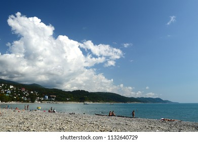 Beach of Sochi with sky, sea and clouds