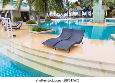 Beach sofa beside swimming pool